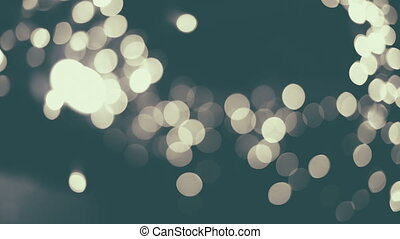 White bokeh lights moving. - White bokeh lights moving close...