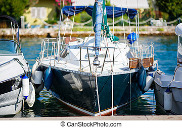 Yachts moored in a marina Tivat, Montenegro - Yachts moored...