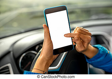 Using smartphone in the car - Female hands using smartphone...