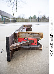 Overturned courtside bench - Overturned bench on a rainy...