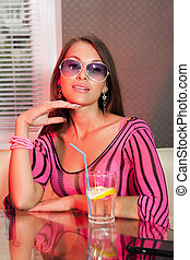 woman drinking alcohol cocktail