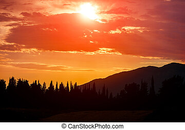 Orange Sun Setting Behind the Mountains in Montenegro