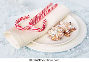 Christmas table with sweets - Two red and white striped...