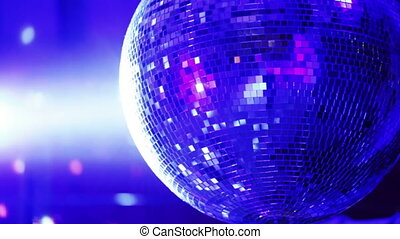 Disco mirror ball - Rotating mirror disco ball in restaurant