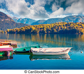 Colorful summer morning on the Bohinj Lake with boats,...