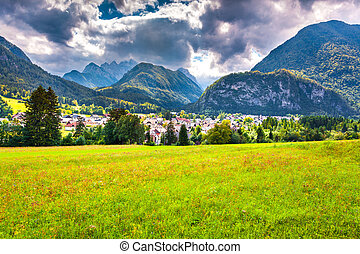 Summer sunny view of Triglav mountain range from the Gozd...