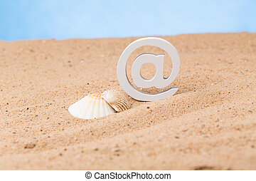 internet round the world - objects in the sand as a symbol...