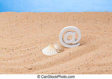 internet at holiday - objects in the sand as a symbol of...