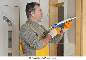 Home renovation, caulking door with silicone