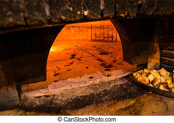 Brick oven in a pizza restaurant in Rome - Brick oven with...