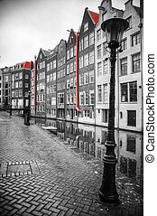black and white photo with elements of red - Amsterdam....