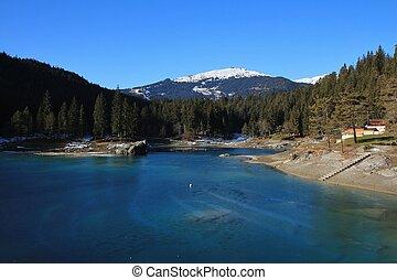 Thin ice on turquoise lake Cauma