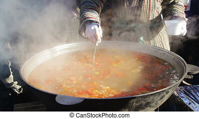 Uzbek cuisine, the chef prepares a hot meal. - The Uzbek...