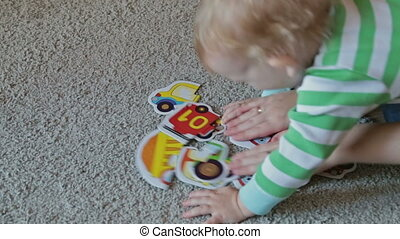 Child playing with puzzles, HD