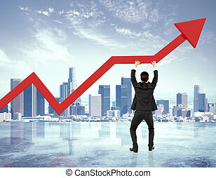 Businessman holding big red arrow up at city background