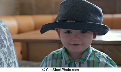 Boy with funny hat throw ball at home - 4 shot - Boy with...
