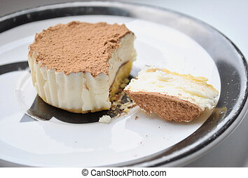 Sweet dessert with cheesecake and cocoa
