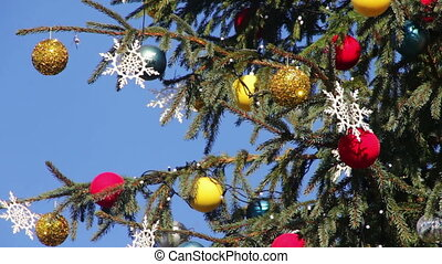 Decorated Christmas tree on background blue sky - Beautiful,...