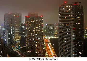 Dense buildings in Minato-ku, night time Tokyo Japan