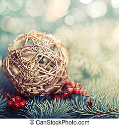 Golden ball. Abstract Xmas decorations over pine tree
