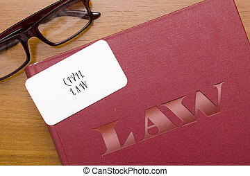 Book of laws in civil law with business card - Legal code in...