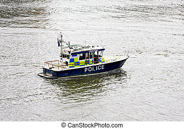 Police boat at river Thames for emergency response