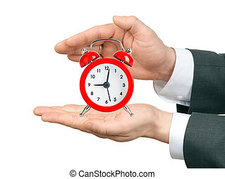 Male hands holding alarm clock on isolated white background
