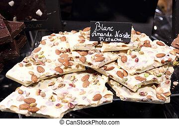 White chocolate with pistachio, almond and hazelnut