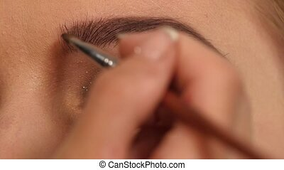 make-up for the young girl: beauty shape of eyebrows using...