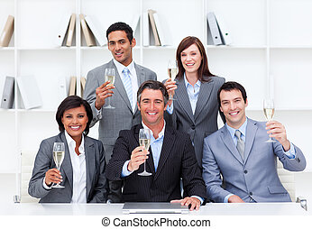 Successful business people celebrating a victory