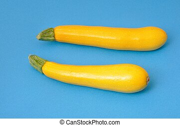 Yellow courgettes on blue background
