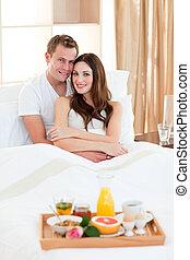Happy couple having an healthy breakfast