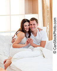 Romantic couple finding out results of a pregnancy test in...