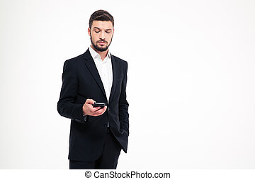 Serious businessman using smartphone - Portrait of a serious...