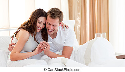 Affectionate couple finding out results of a pregnancy test