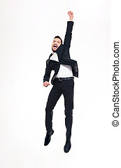 Happy excited handsome young businessman jumping and...