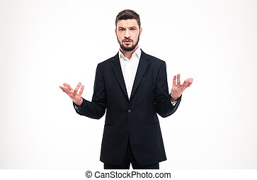 Handsome puzzled businessman with beard holding copyspace in...