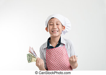 Happy young chef holding Thai Baht money in his hand on grey...