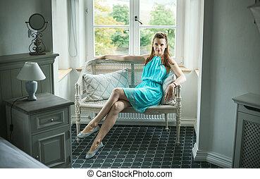 Pretty brunette sitting on the wicker bench - Pretty...