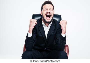 Delighted happy bearded young businessman sitting and...