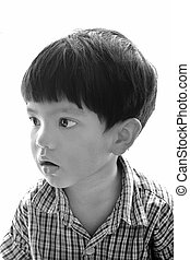 Absent-minded little boy - Black and white photo portrait of...