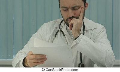Tired medical doctor tired from paper work with documents -...