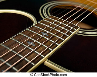 Acoustic guitar fretboard - closeup of acoustic guitar with...