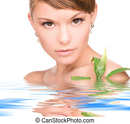 woman with sprout - picture of woman with sprout in water