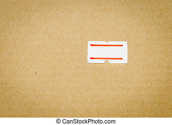 blank price tag label attached on brown paper background
