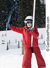 Boy on a ski lift - Smiling boy on a ski lift carrying ski...