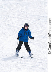 Boy skiing - Smiling boy on skis at bottom of ski slope