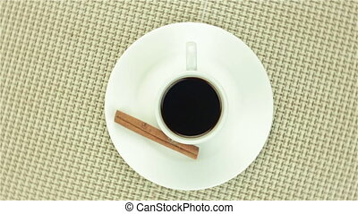 Cup of coffee with cinnamon on colour napkin - Cup of coffee...