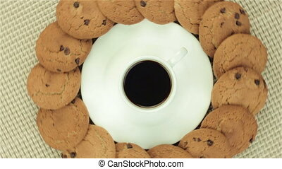 Cookies and cup of coffee, video on colour napkin