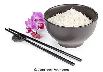 bowl of basmati rice, chopsticks and orchid flower